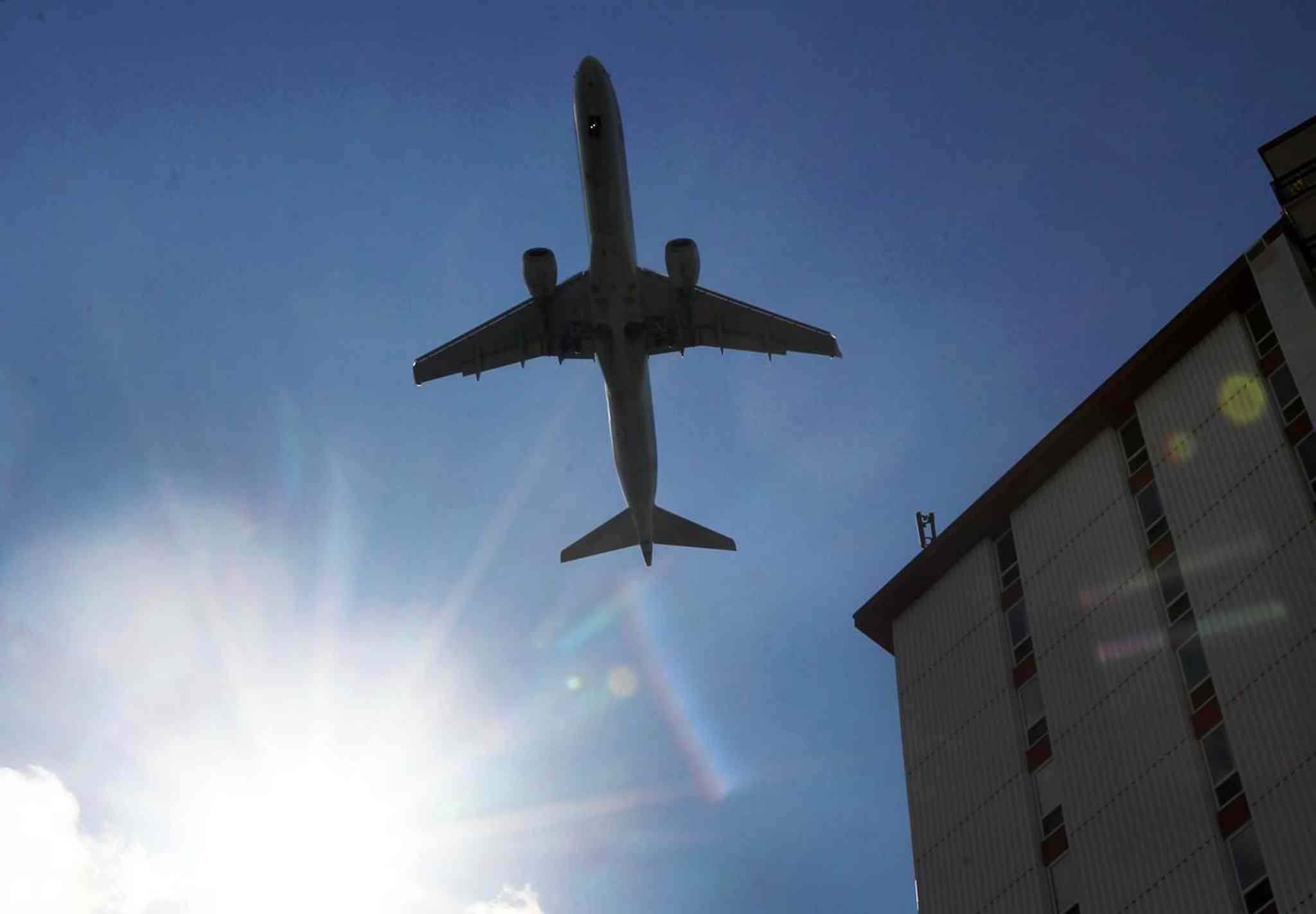 A plane takes off from Richardson International Airport in Winnipeg on Monday from a northwest-southeast runway while the regular north-south runway is rehabilitated.  The change has resulted in an increase in air traffic in some southwest Winnipeg neighbourhoods.