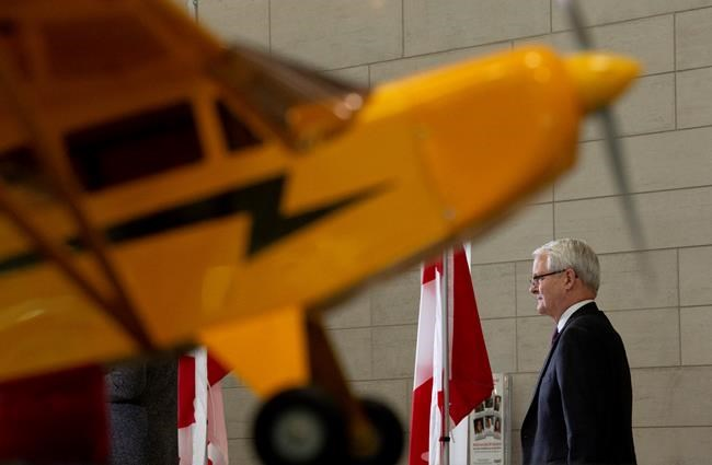 Transport Minister Marc Garneau waits to speak about passenger rights during a news conference at the airport in Ottawa, Monday December 17, 2018. THE CANADIAN PRESS/Adrian Wyld