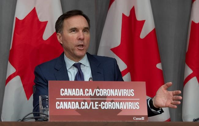 Minister of Finance Bill Morneau responds to a question during a news conference in Ottawa, Friday, March 27, 2020. THE CANADIAN PRESS/Adrian Wyld