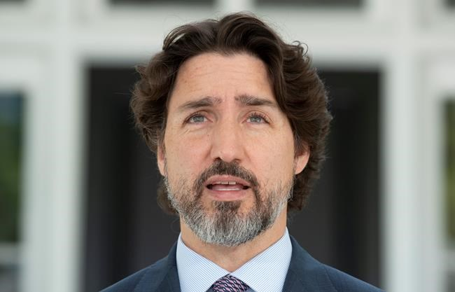 Prime Minister Justin Trudeau delivers his opening remarks at the start of a news conference outside Rideau Cottage in Ottawa, Wednesday May 27, 2020. THE CANADIAN PRESS/Adrian Wyld