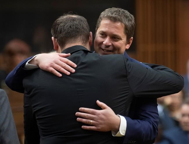 Conservative MP's pay their respects to Leader of the Opposition Andrew Scheer following the announcement he will step down as leader of the Conservatives. His departure leaves the Conservative party at a crossroads. It needs to decide what it wants to be: a one-dimensional, old-style organization that drags around social-conservative baggage or a modern, progressive one with smart, practical ideas on how to run the country. (Adrian Wyld / Canadian Press files)