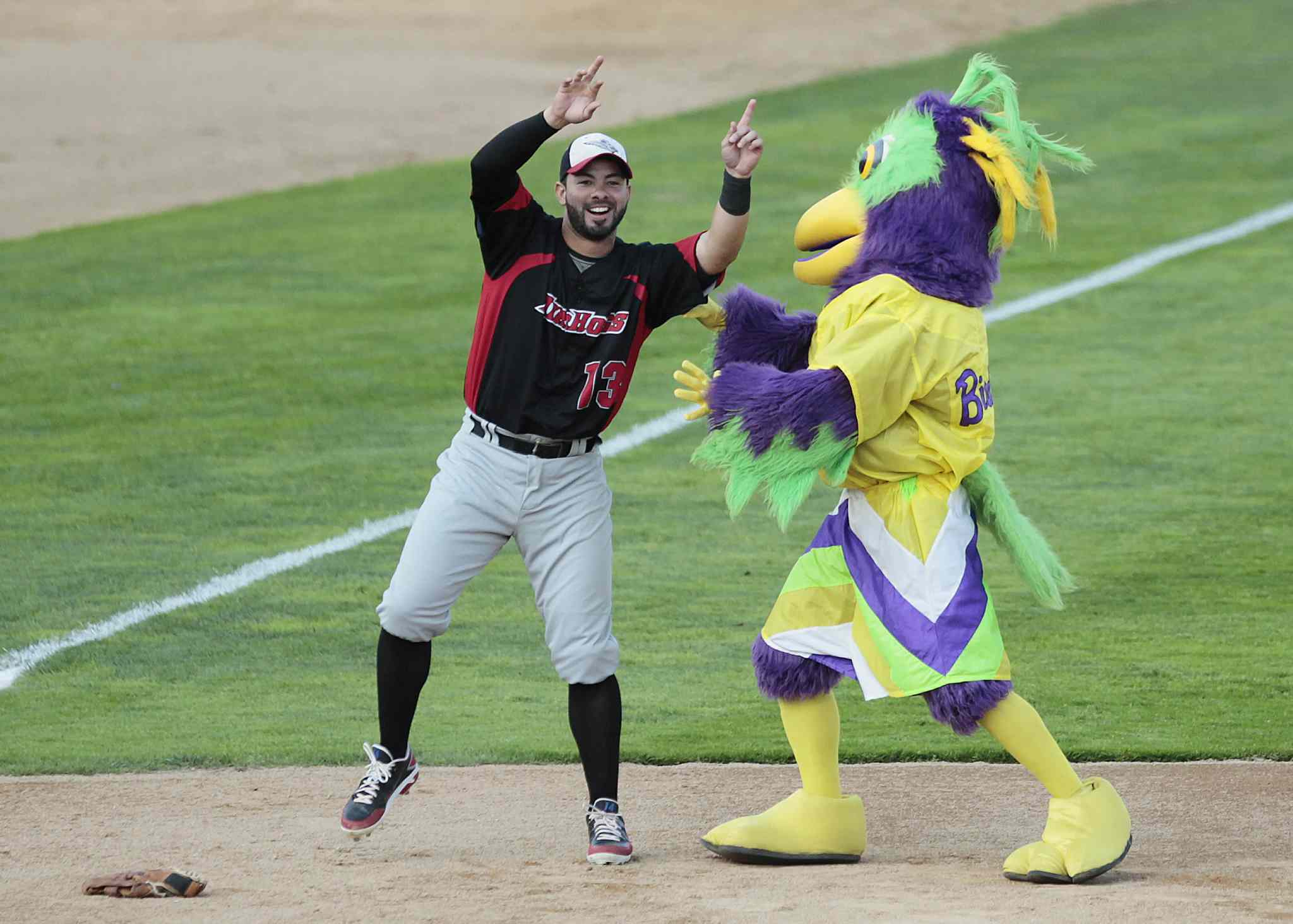 Grand Prairie Air Hogs Adel Nieves jokes around with a mascot during Tuesday's All-Star game.