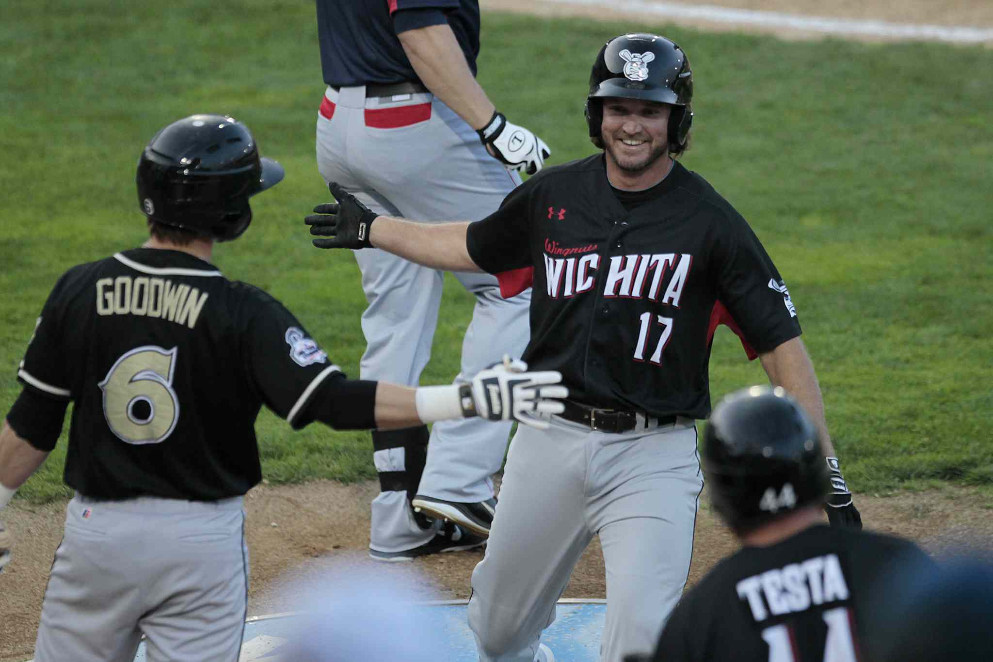 Witchita Wingnuts' Patrick Mincey (#17) hits a home-run in the 2014 American Association All-Star game in Winnipeg Tuesday.