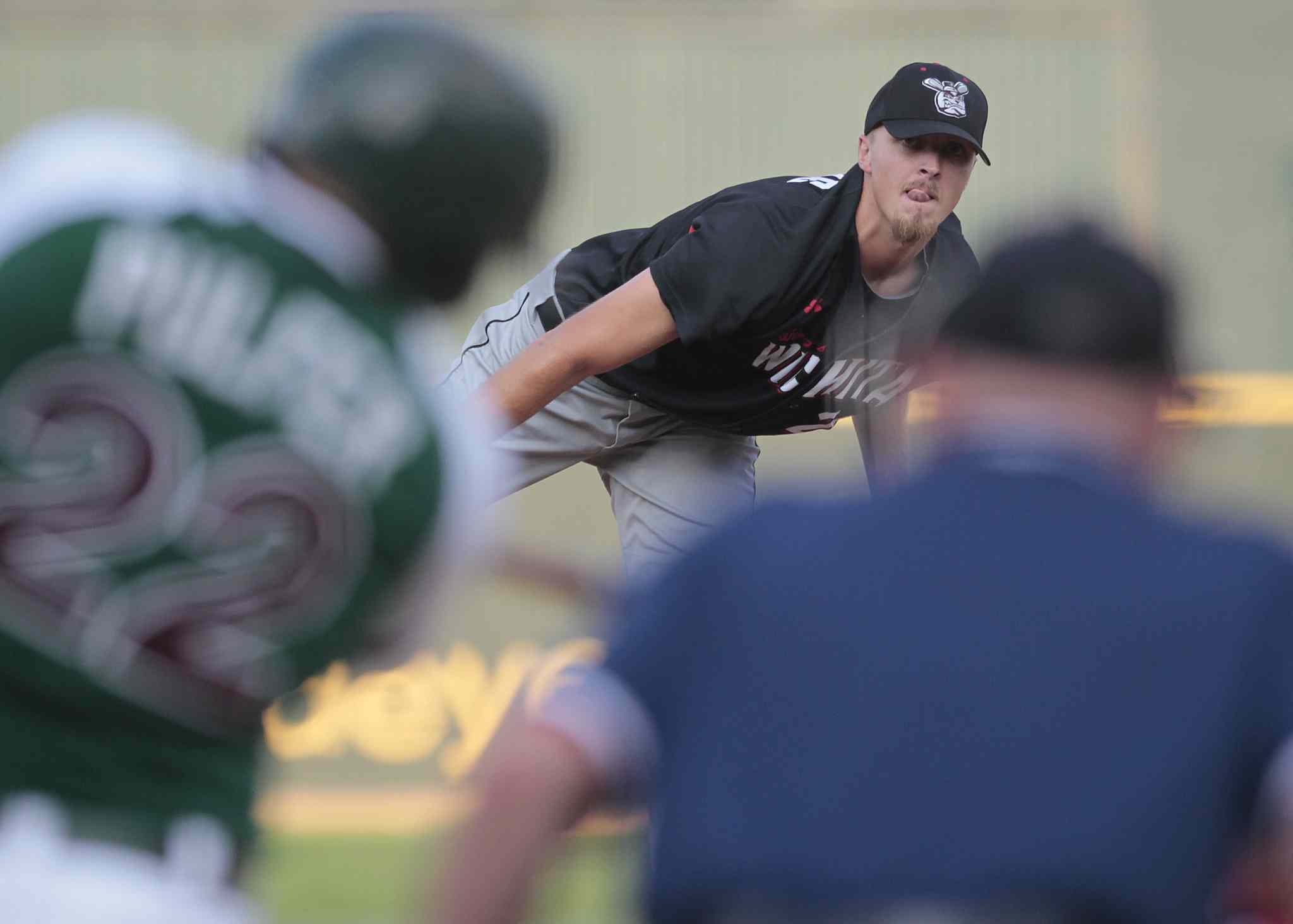 Team South opening pitcher Jason Van Skike throws in the 2014 American Association All-Star game in Winnipeg Tuesday.