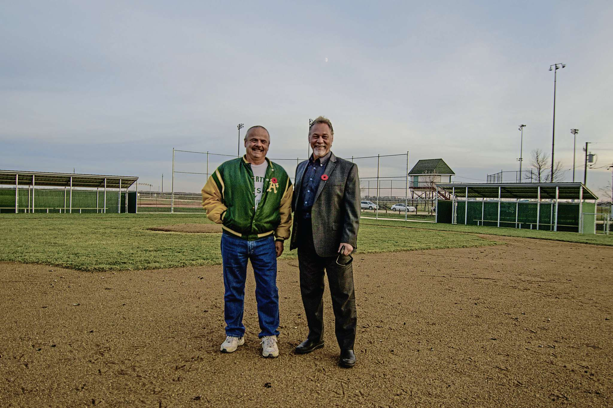 Optimist Park director Moe Gervais (left) and fundraising director Ken Kurtz stand on one of the park's recently completed diamonds.