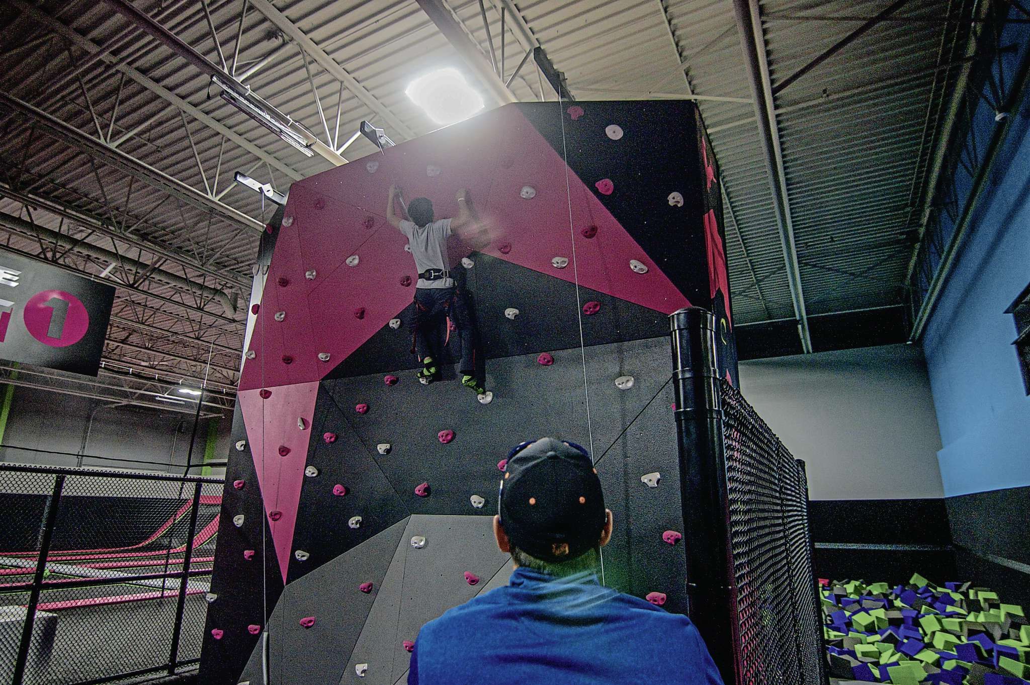 Flying Squirrel has a rock climbing wall (pictured) and foam pits with a gladiator beam and slack line.