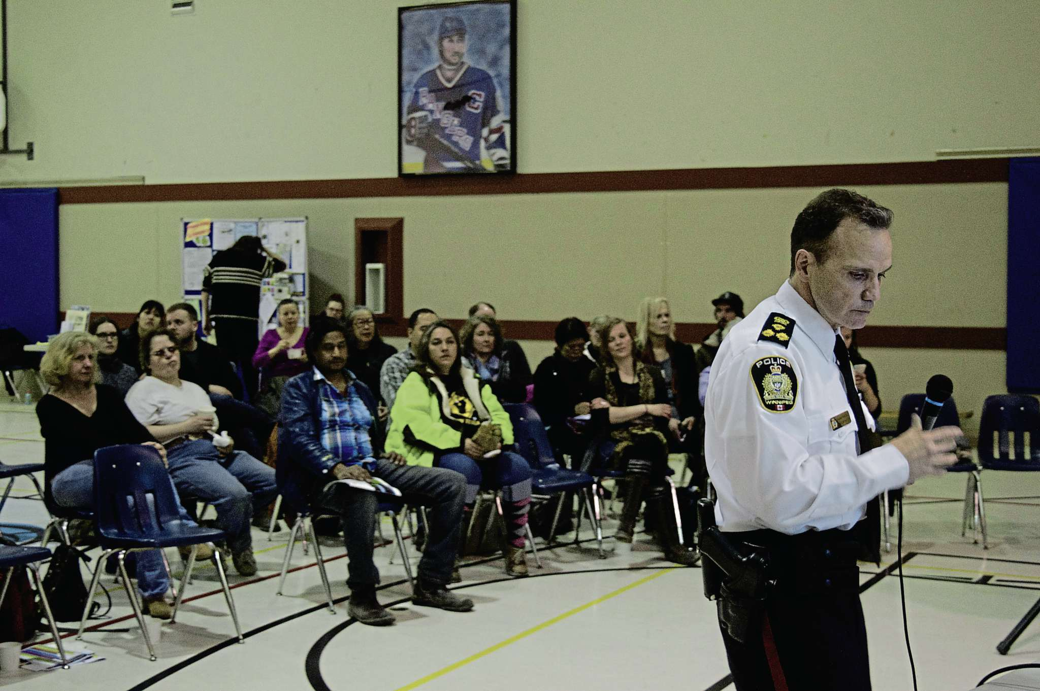 Winnipeg Police chief Danny Smyth talks to West End residents at a town hall on March 29.