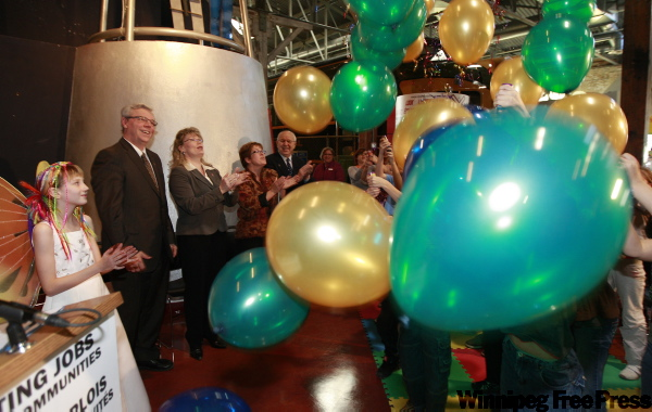 Eleven-year-old Teresa van Eerd (from left) with Premier Greg Selinger, MP Shelly Glover, Children's Museum executive director Diana Doth and Laurie Pollard watch as balloons drop into a crowd of children after the governments announced they would help fund a $9.5-million renovation project at the museum.