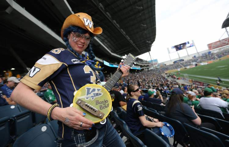 Heather Buchanan gets herself tuned up for the Banjo Bowl as the Winnipeg Blue Bombers take on the Saskatchewan Roughriders at Investors Group Field Sunday.  (Trevor hagan / Winnipeg Free Press)