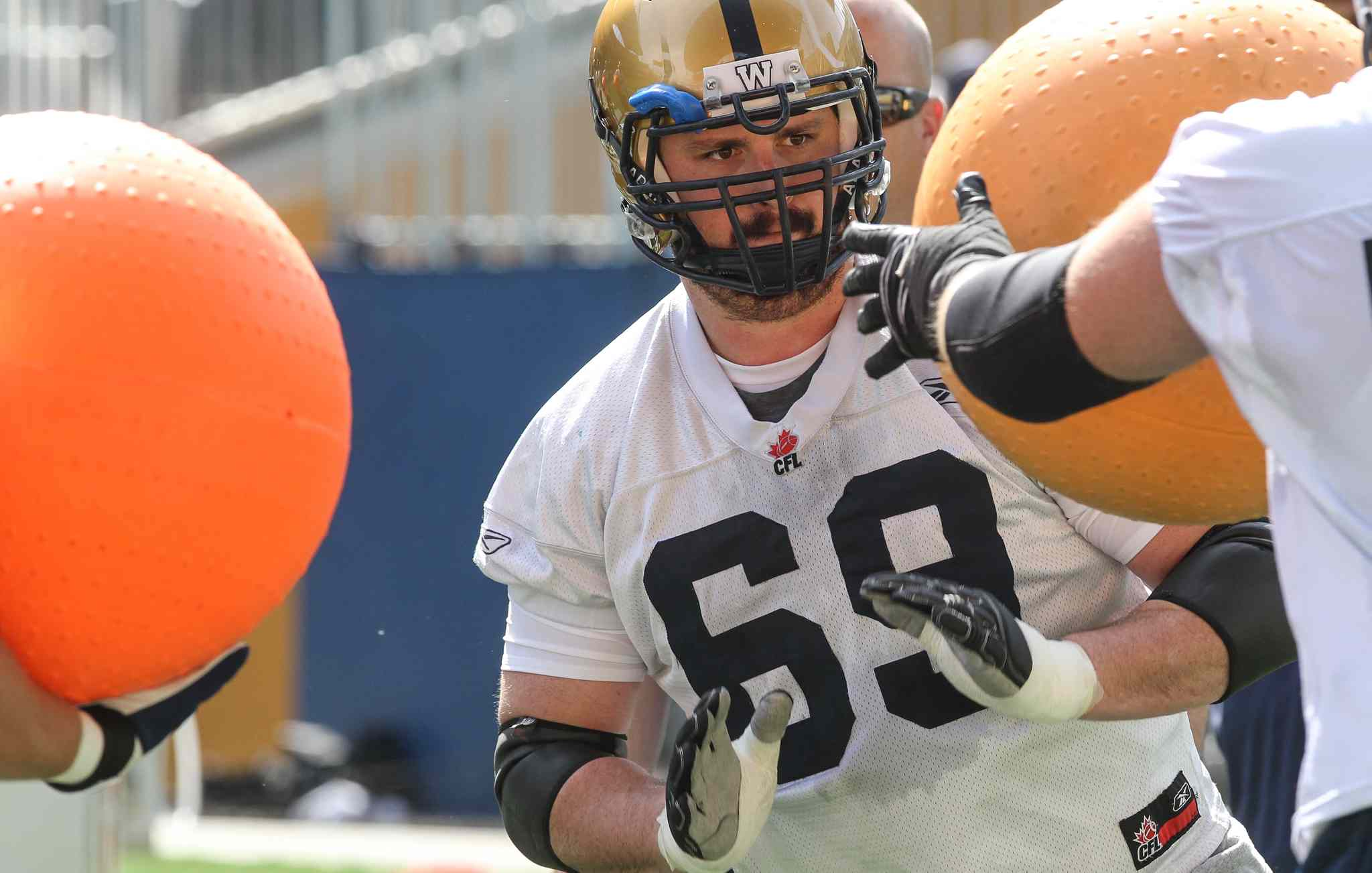 Glenn January takes on the Big Balls during the first official day of the Winnipeg Blue Bombers training camp at Investors Group Field Sunday morning.