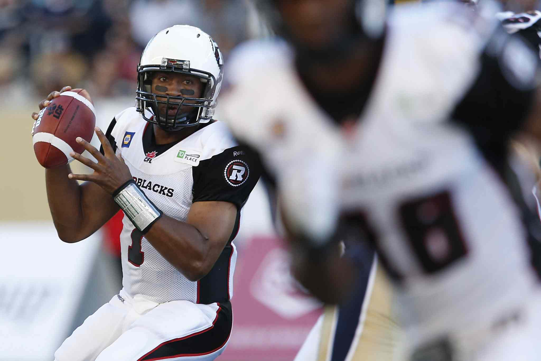 Ottawa Redblacks' quarterback Henry Burris (1) gets set to throw against the Winnipeg Blue Bombers during the first half of Thursday's game at Investors Group Field.