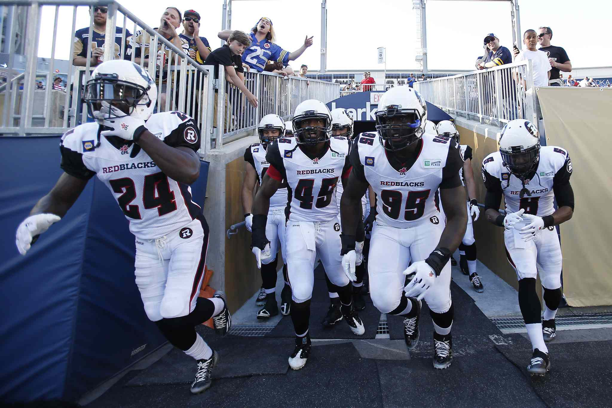 Ottawa Redblacks hit the field for their CFL game against the Winnipeg Blue Bombers in Winnipeg on Thursday.