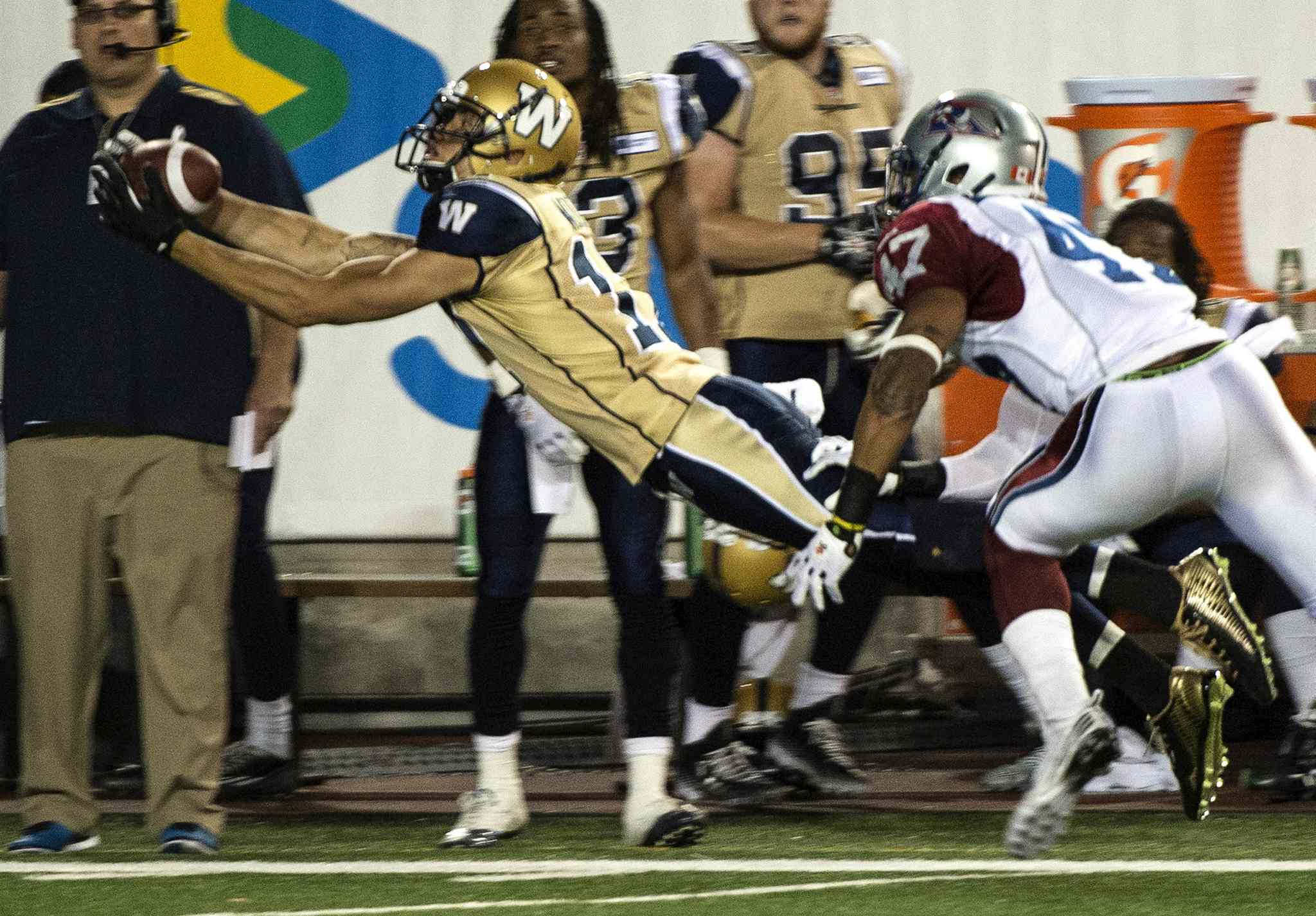 Winnipeg Blue Bombers' slotback Nick Moore catches a pass in front of Montreal Alouettes' defensive back Jamaan Webb during the third quarter of Friday's game.