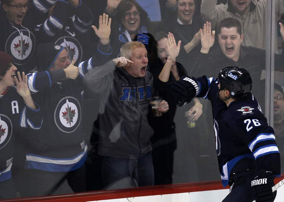 Photographer's choice: The 119-day NHL lockout was felt hard by Winnipeg Jets fans as it happened at the beginning of our second year back in the big leagues. On their second game on home ice since the lockout ended, the Jets played host to Sidney Crosby and the Pittsburg Penguins. Crosby scored twice in the opening period but the Jets rallied back and won. Blake Wheeler scored on an empty net and sealed the big win at 18:51 in the third. The fans went wild, and I just loved the intense passion of the fans that night.  January 25, 2013   (JOE BRYKSA / WINNIPEG FREE PRESS)