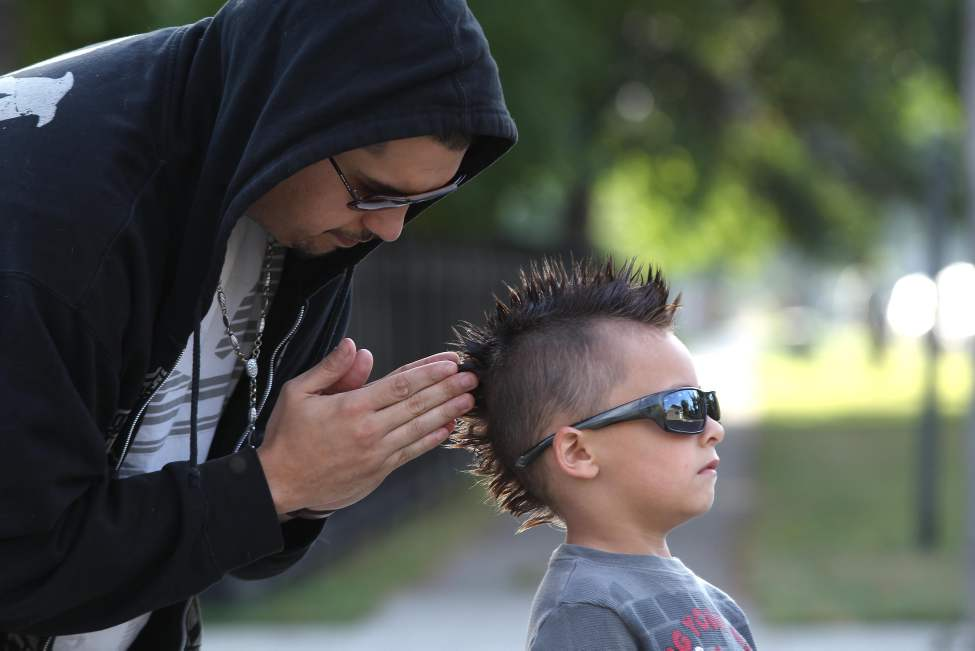 Father Jose Recabarren does some last minute adjustments on his six-year-old son Saint's mohawk before he heads to school. September 11, 2013   (JOE BRYKSA / WINNIPEG FREE PRESS)