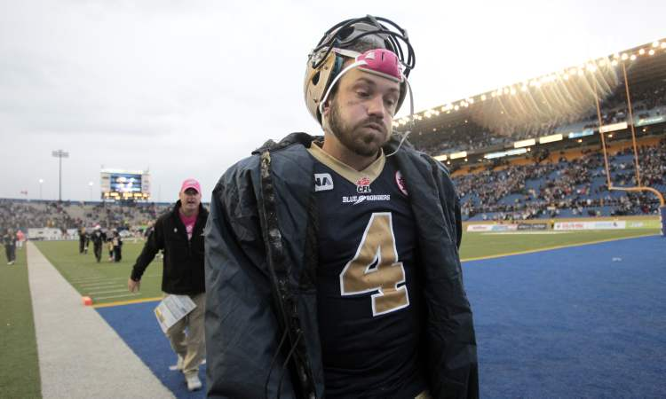 An exhausted Buck Pierce (4) leaves the field after winning the game against the Montreal Alouettes 26-25. Winnipeg Blue Bombers played the Montreal Alouettes at Canad Inns Stadium in a Saturday afternoon CFL game. 