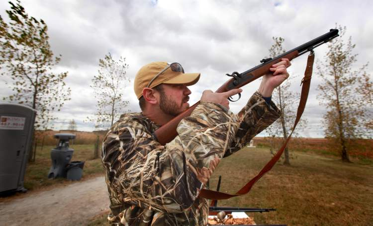 Winnipeg Blue Bomber QB Buck Pierce fires a muzzleloader while attending Provincial Hunting Day - Manitoba Wildlife Federation's fourth annual event at Oak Hammock Marsh with Glenn January Saturday afternoon.