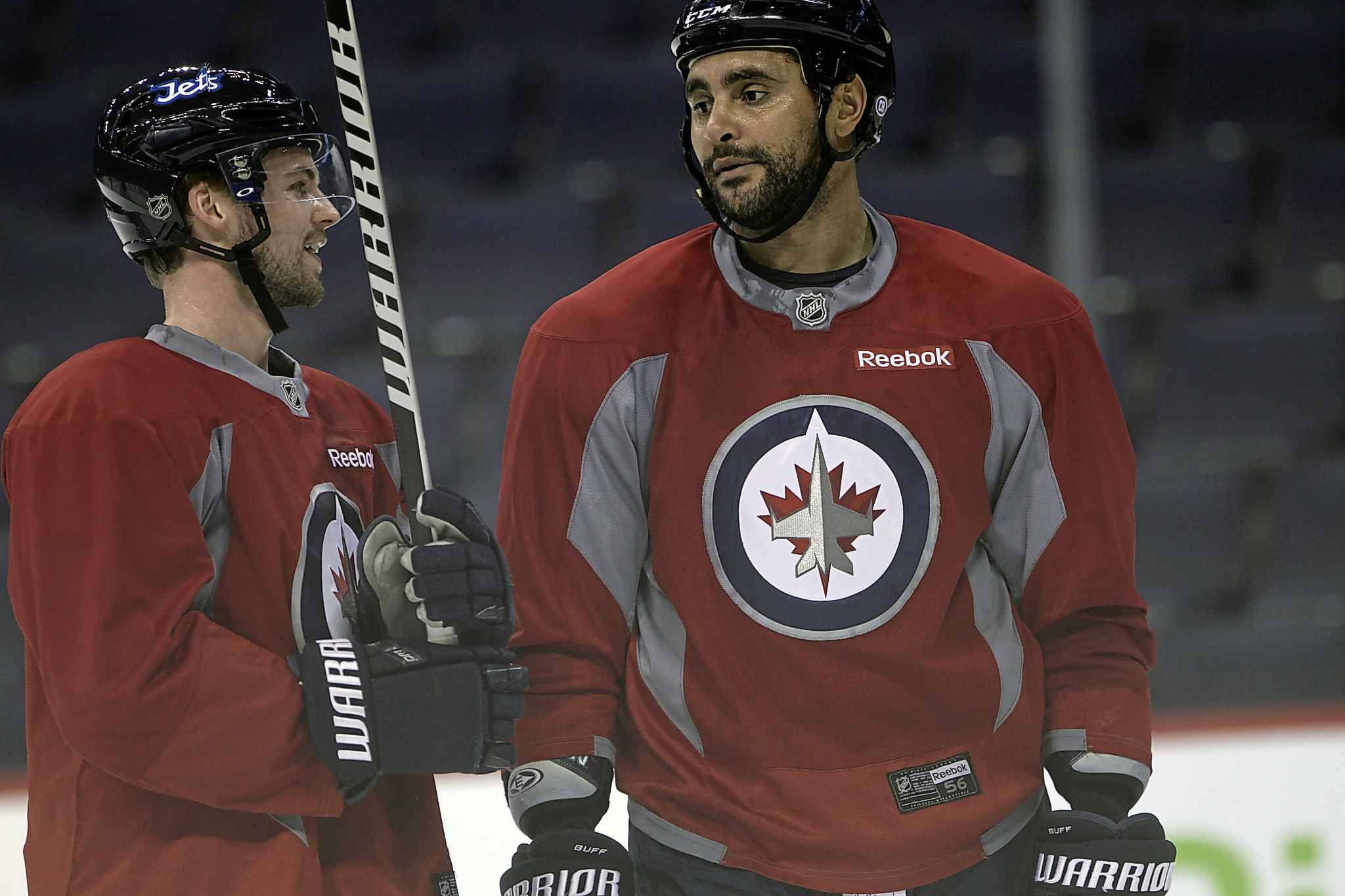 Josh Morrissey (left) says Byfuglien was a mentor to him in his first season with the Jets in 2016. (Joe Bryksa / Winnipeg Free Press files)