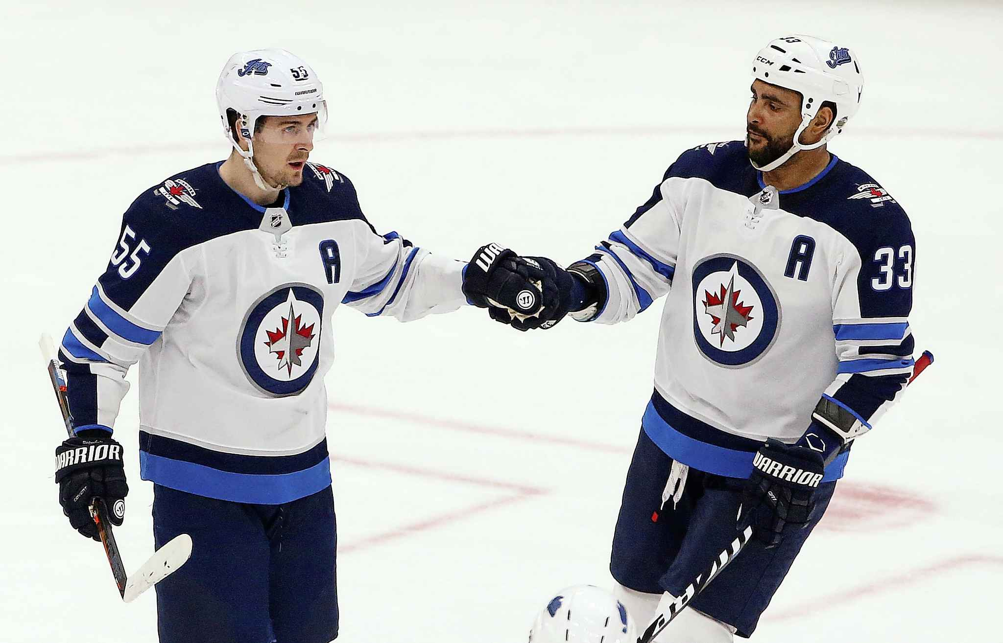 """""""You just gotta wish him the best in his life. You just wish happiness and healthiness for him and his family and that's about it,"""" Scheifele (left) said of Byfuglien. (Ross D. Franklin / The Canadian Press files)"""
