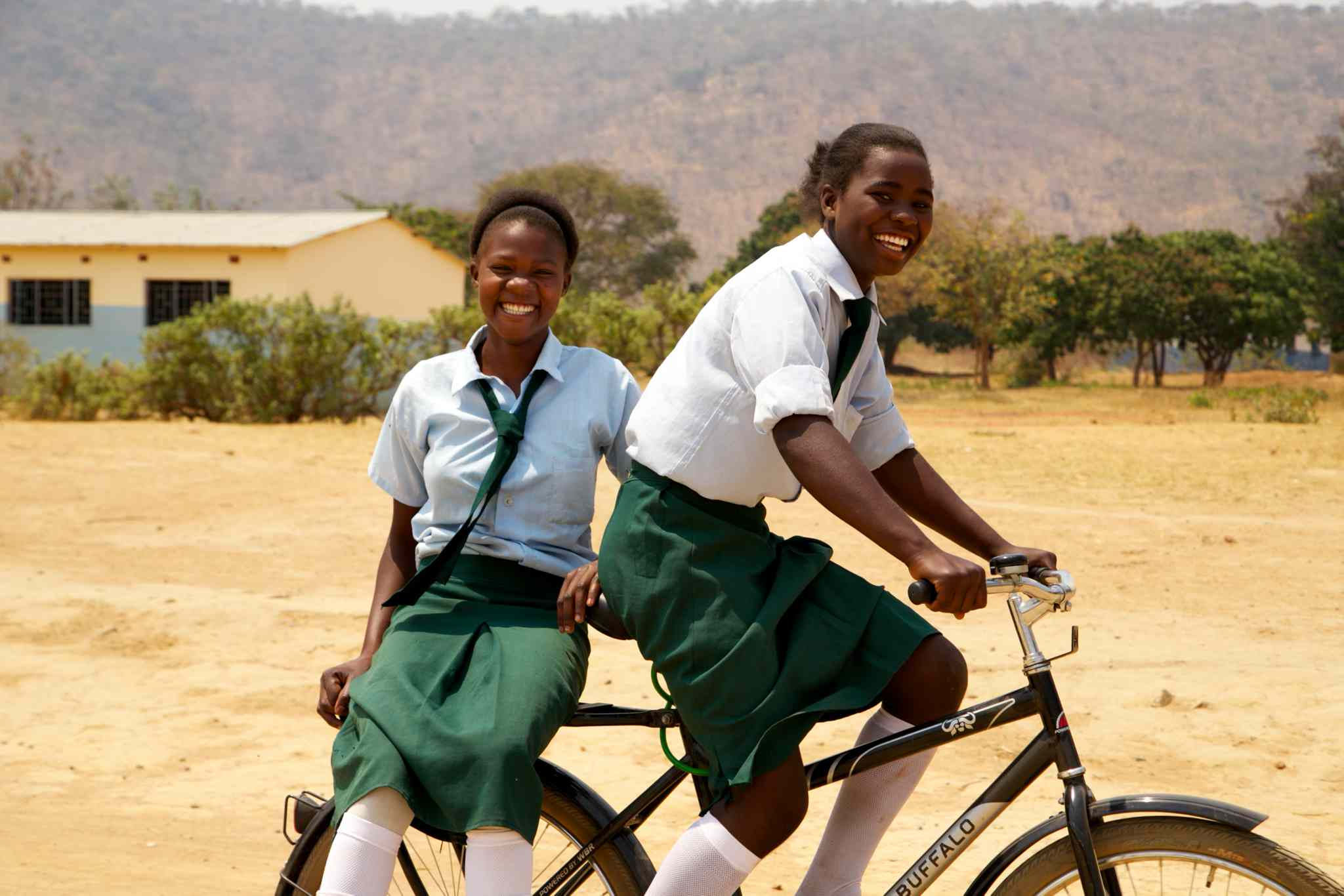 Students living in rural areas use the bikes to get to school regularly and on time. With access to the Buffalo Bikes, student attendance and performance greatly improve.