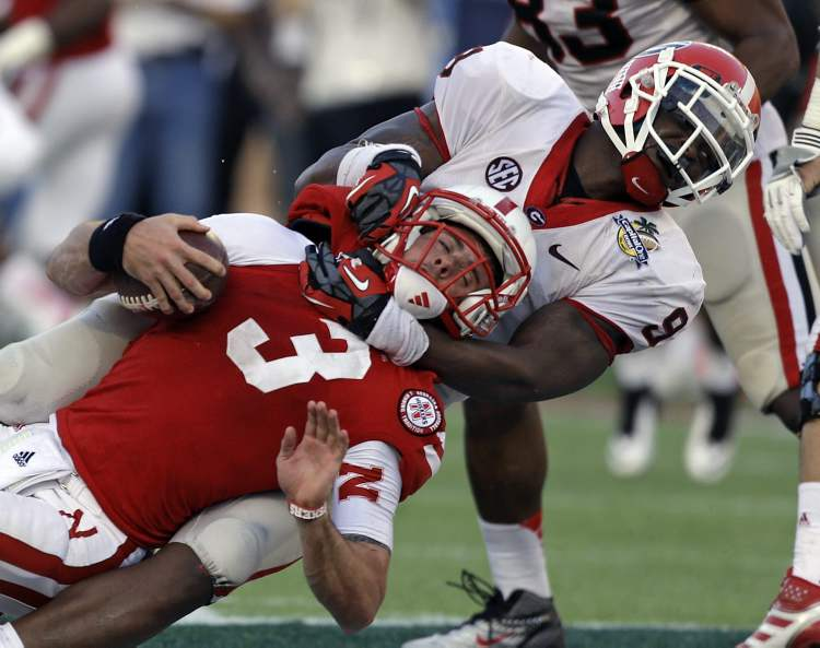 Georgia linebacker Alec Ogletree (9) sacks Nebraska quarterback Taylor Martinez (3) on a fourth and nine play late in the fourth quarter of the Capital One Bowl NCAA college football game Tuesday in Orlando, Fla. Georgia won 45-31.