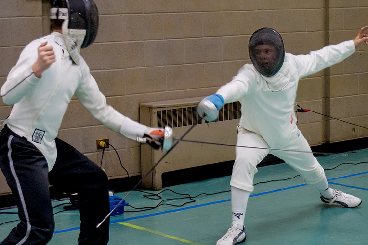 Two members of the Lightning Fencing Club cross épées. You can try this out too, by visiting their Wolseley-based fencing salle.