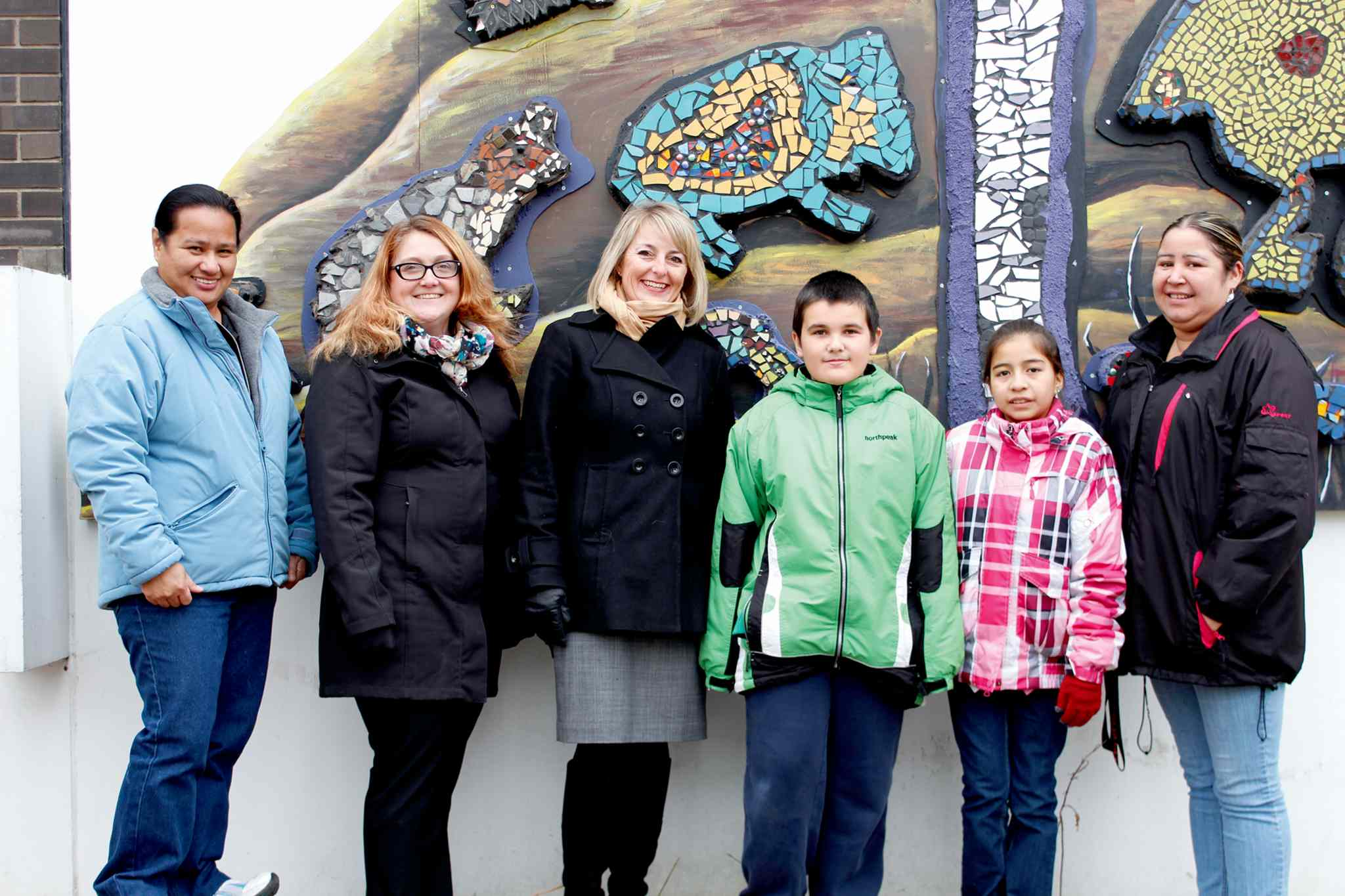 From left to right: educational assistant Melrose Bico, vice-principal Suzanne Mole, principal Brenda Langton, Grade 6 students Logan Martins and Juana Arias, and community support worker Livia Bales.