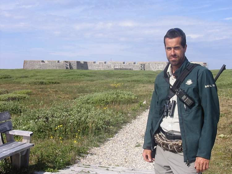 Dave Allcorn, who protects tour groups from polar bears in the vicinity, stands outside Fort Prince of Wales.