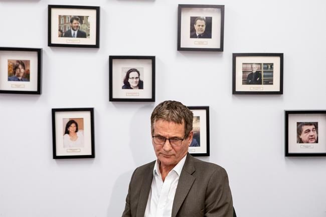 David Milgaard, who spent 23 years in prison after being wrongfully convicted of murder, is seated in front of photos of other people who have suffered wrongful convictions, during a press conference held by Innocence Canada, in Toronto, on Wednesday October 10, 2019. The advocacy group has announced that the country's major federal parties have committed to creating a special tribunal to investigate wrongful convictions. THE CANADIAN PRESS/Chris Young