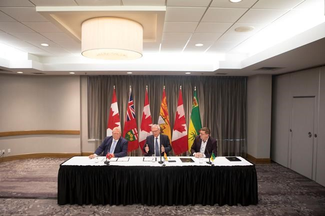 "Ontario Premier Doug Ford, left to right, New Brunswick Premier Blaine Higgs and Saskatchewan Premier Scott Moe sit as they talk to the media in Toronto on Sunday, Dec. 1, 2019. The premiers signed a ""Collaboration Memorandum of Understanding"" ahead of a meeting of Canada's provincial leaders. THE CANADIAN PRESS/Chris Young"