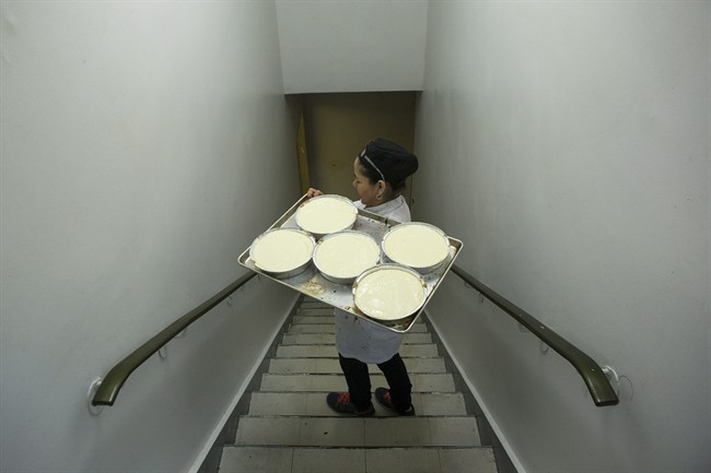 A tray of dessert dishes is carried at Modern Kosher Catering at Toronto's Adath Israel synagogue on Wednesday, March 25, 2015. THE CANADIAN PRESS/Chris Young
