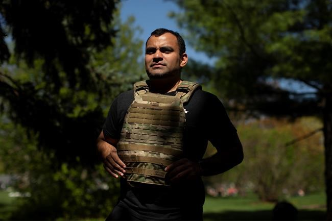 "Crossfit enthusiast David Rios is pictured wearing his weighted vest, in Toronto, on Saturday, May 16, 2020. David Rios will miss ""Murph."" The classic Crossfit workout is named for Michael Murphy, a U.S. Navy Seal who died in Afghanistan in 2005, and received the Medal of Honor.THE CANADIAN PRESS/Chris Young"