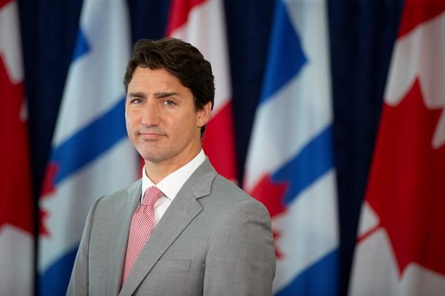 Prime Minister Justin Trudeau takes questions from journalists following a meeting with Toronto Mayor John Tory at Toronto City Hall, on Tuesday August 13, 2019. Ethics Commissioner Mario Dion says Trudeau contravened a section of the Conflict of Interest Act.THE CANADIAN PRESS/Chris Young
