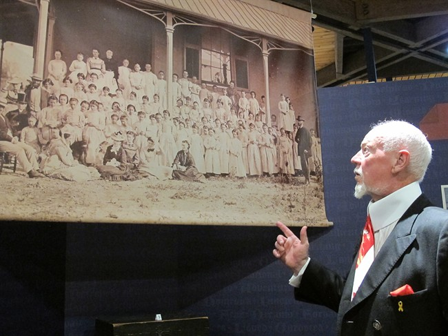 Don Cherry points to a photo at the opening of an exhibition honouring British home children who served overseas in the First World War in Toronto on Monday, July 28, 2014. Cherry's grandfather was a home child and a veteran. THE CANADIAN PRESS/Colin Perkel
