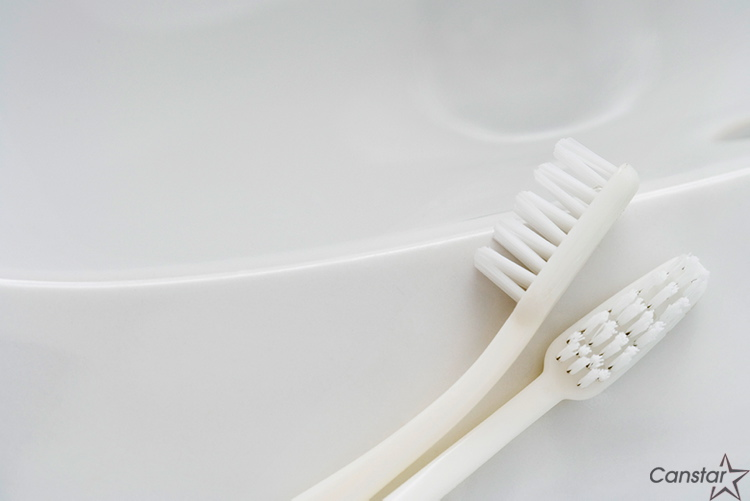 A toothbrush is a handy tool to use when scrubbing the grout on kitchen floors.