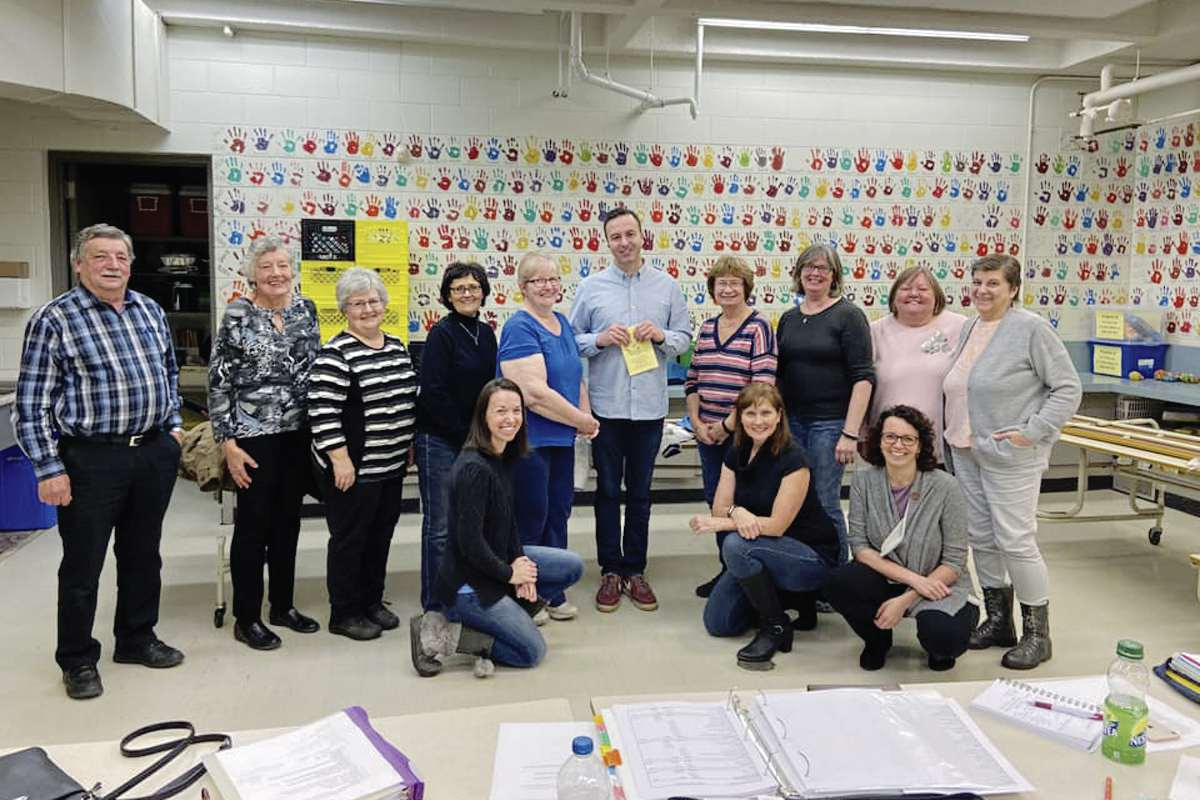 MLA Adrien Sala (centre) with the volunteers of the St. James Horticultural Society.