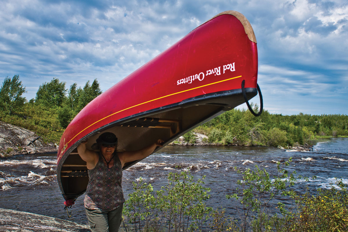 RoseAnna Schick on a portage during her tour along Manitoba's Manigotagan River, which she went on with Red River Outfitters.