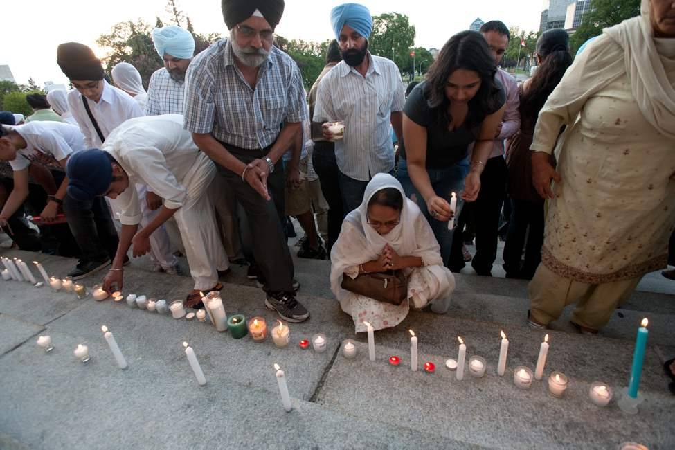 A gathering of 200 predominately Sikh formed in front of the legislature to lay candles, pray and hear speakers to honour the lives lost in the Sikh temple shooting in Wisconsin.  August 10, 2012. (COLE BREILAND / WINNIPEG FREE PRESS)