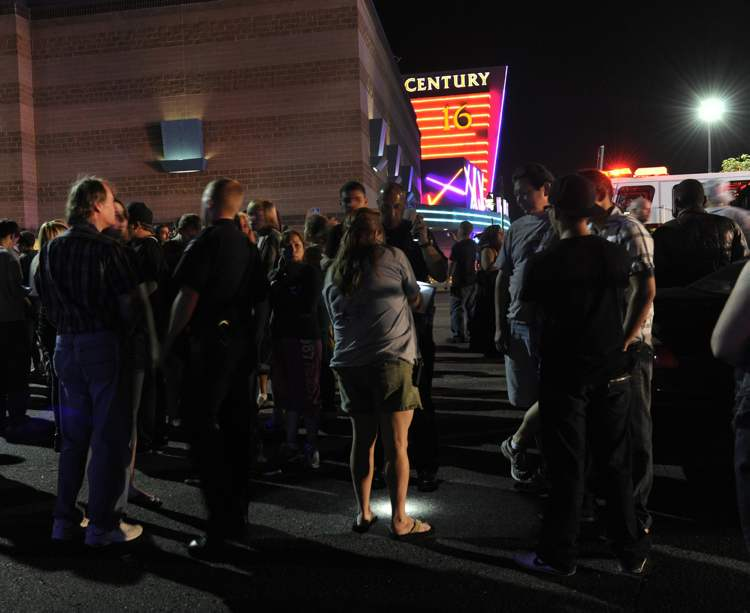 Aurora Police respond to the Century 16 movie theatre early Friday morning, July 20, 2012.  Police chief Dan Oates said at least 14 dead and another 50 injured in the Colorado theater shooting. (AP Photo/Karl Gehring, The Denver Post) (CP)