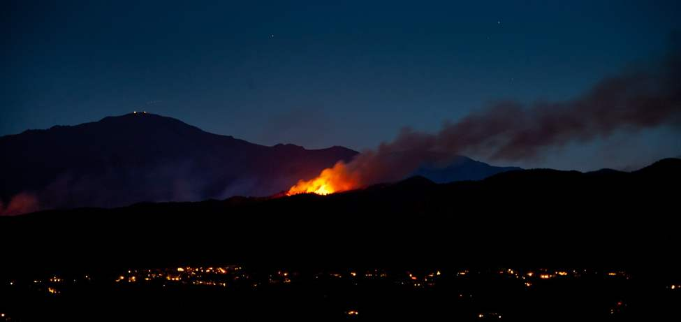 A flare-up from the Waldo Canyon Fire burns on a ridge west of Colorado Springs, Colo., Monday night, June 25, 2012. (AP PHOTO/THE GAZETTE,MARK REIS)