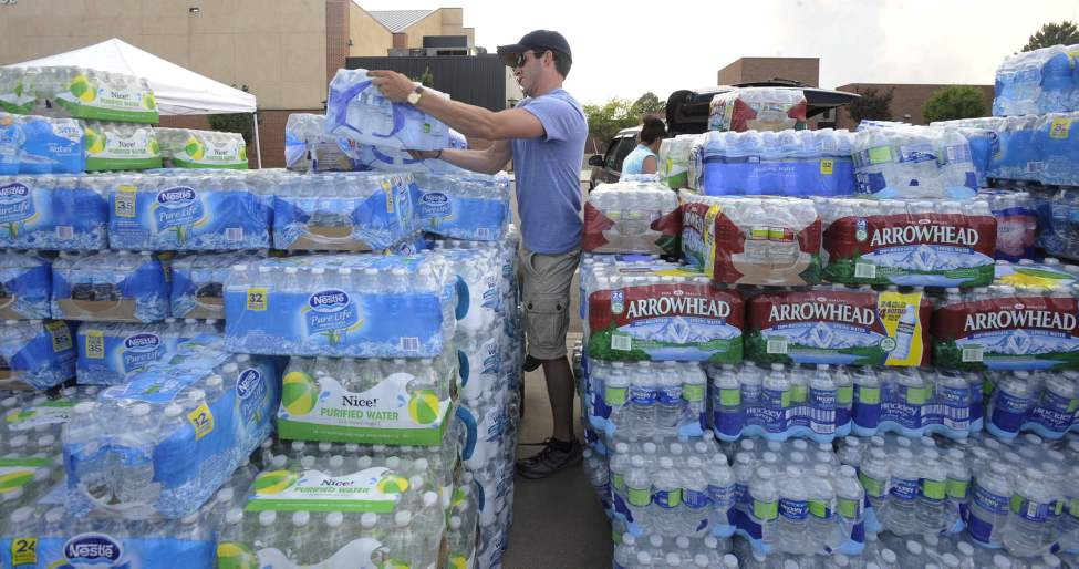 Ben Jourdan from the El Pomar Foundation stacks donated water for the firefighters in Colorado Springs, Colorado, on Sunday, June 24, 2012. (Jerilee Bennett/Colorado Springs Gazette/MCT)