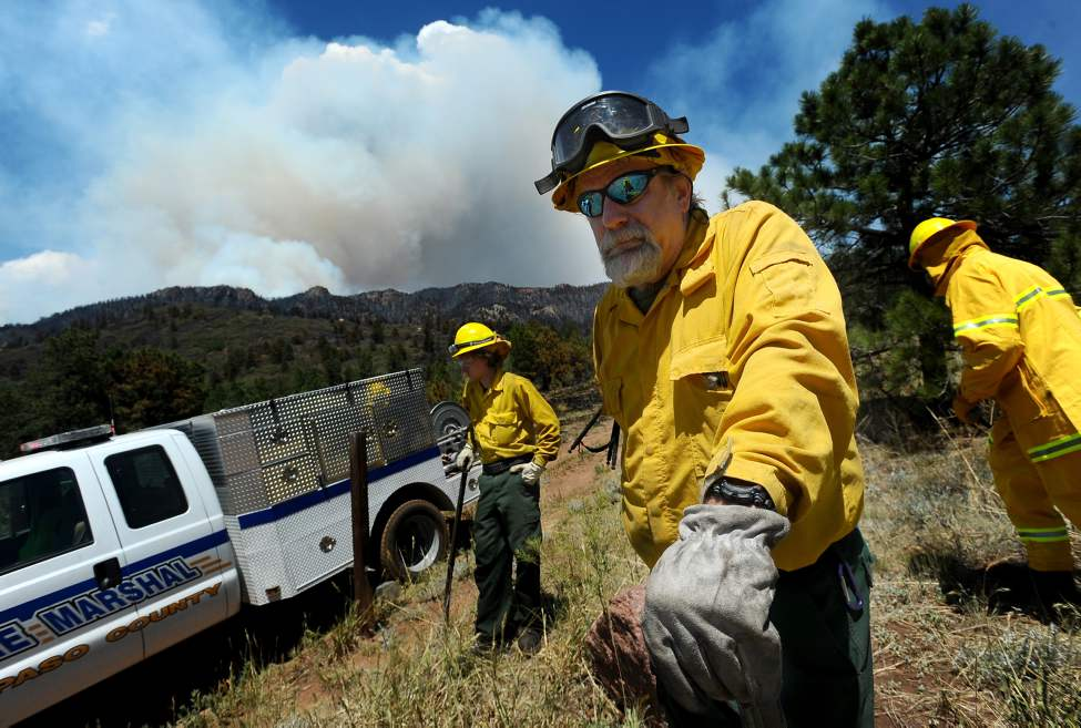 El Paso County Sheriff's Department wild land fire fighters George Bennett, right, and Connor Barkley stand watch near Cascade, Colorado, as the Waldo Canyon fire burns Tuesday, June 26, 2012. (Christian Murdock/Colorado Springs Gazette/MCT)