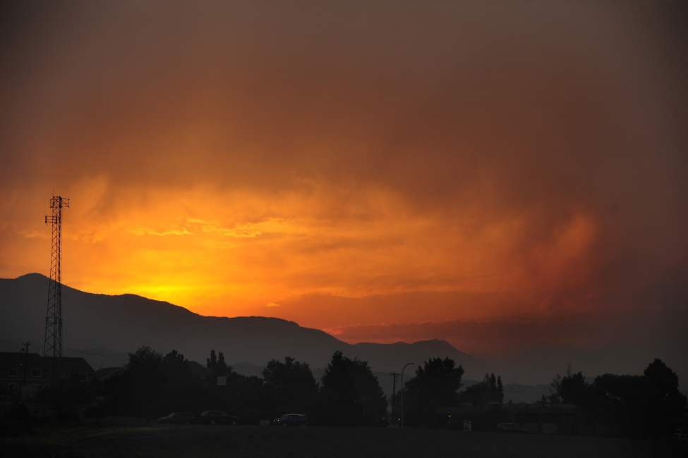 The sun sets over the Waldo Canyon Fire, June 24, 2012 as seen from Lower Gold Camp Road in Colorado Springs, Colorado. (Susannah Kay/Colorado Springs Gazette/MCT)