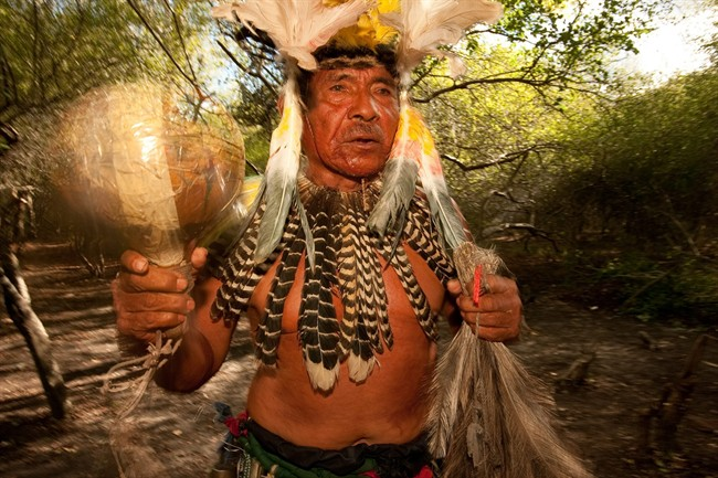 Tito Perez, a shaman from the Chamacoco community in Puerto Diana, Paraguay, is shown.
