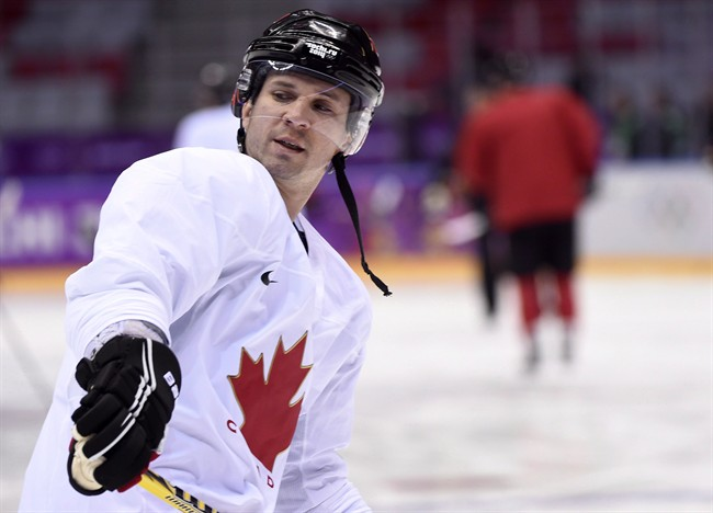 Team Canada forward Martin St. Louis and his teammates take part in their first men's hockey practice during the 2014 Sochi Winter Olympics in Sochi, Russia on Monday, February 10, 2014. A helmet worn by St. Louis in the men's Olympic final and pucks from the women's bronze-medal game are among the items being donated for an exhibition at the Hockey Hall of Fame.THE CANADIAN PRESS/Nathan Denette