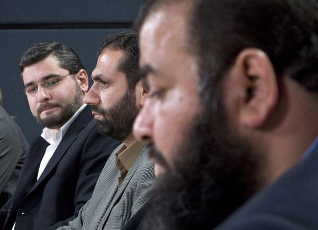 "From left, Abdullah Almalki, Muayyed Nureddin and Ahmad El Maati comment a report in Ottawa, in this Oct.21, 2008 photo. The federal government is rejecting a United Nations criticism that said Canada was ""complicit"" in a human rights violation committed against three Arab-Canadian men held in Syria after 9-11. A UN Committee Against Torture called for Canada to apologize to the three men last week. THE CANADIAN PRESS/Adrian Wyld"