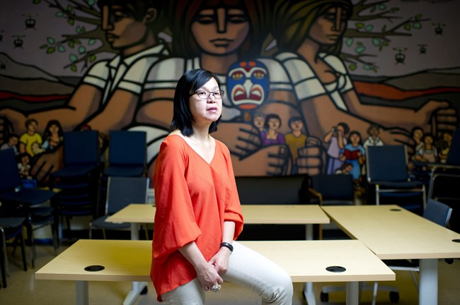 Manager of settlement programs, Khim Tan, poses for a photo in the community room at Mosaic, in Vancouver, B.C. on Monday, May 6, 2013. Mosaic is a non-profit resource centre for immigrants and refugees. THE CANADIAN PRESS/Jimmy Jeong