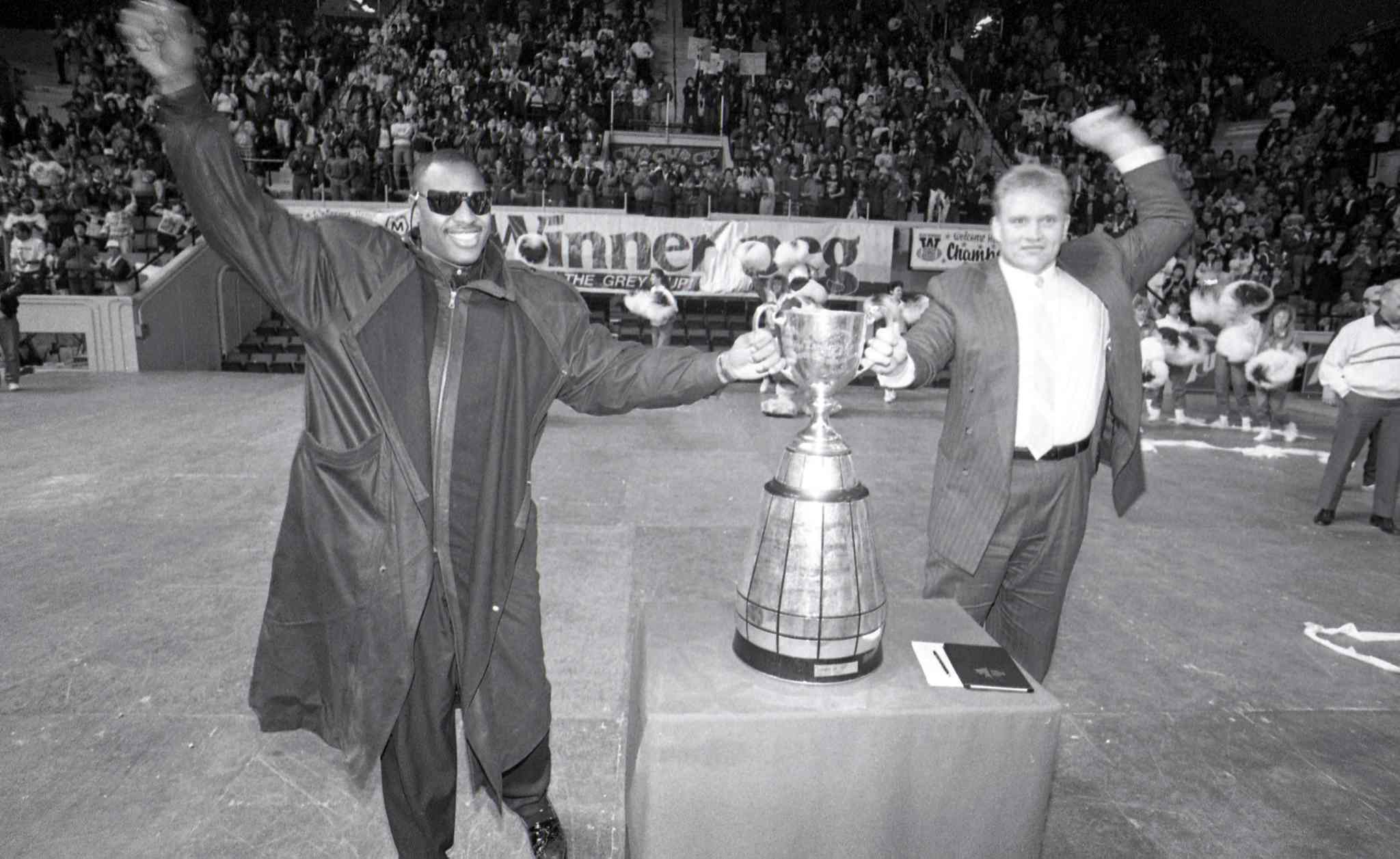 James West and Lyle Bauer at Winnipeg Blue Bomber Grey Cup rally at the Winnipeg Arena. November 26, 1990