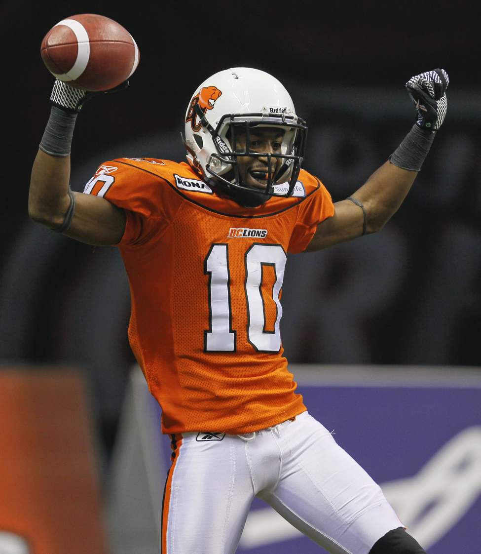 B.C. Lions' Kierrie Johnson celebrates his touchdown during second-half action.  (John Woods / Postmedia News)