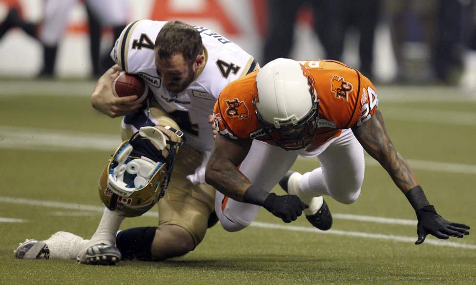 Winnipeg Blue Bombers quarterback Buck Pierce is tackled by B.C. Lions defensive back Korey Banks  during first-quarter action.  (THE CANADIAN PRESS/Jonathan Hayward)